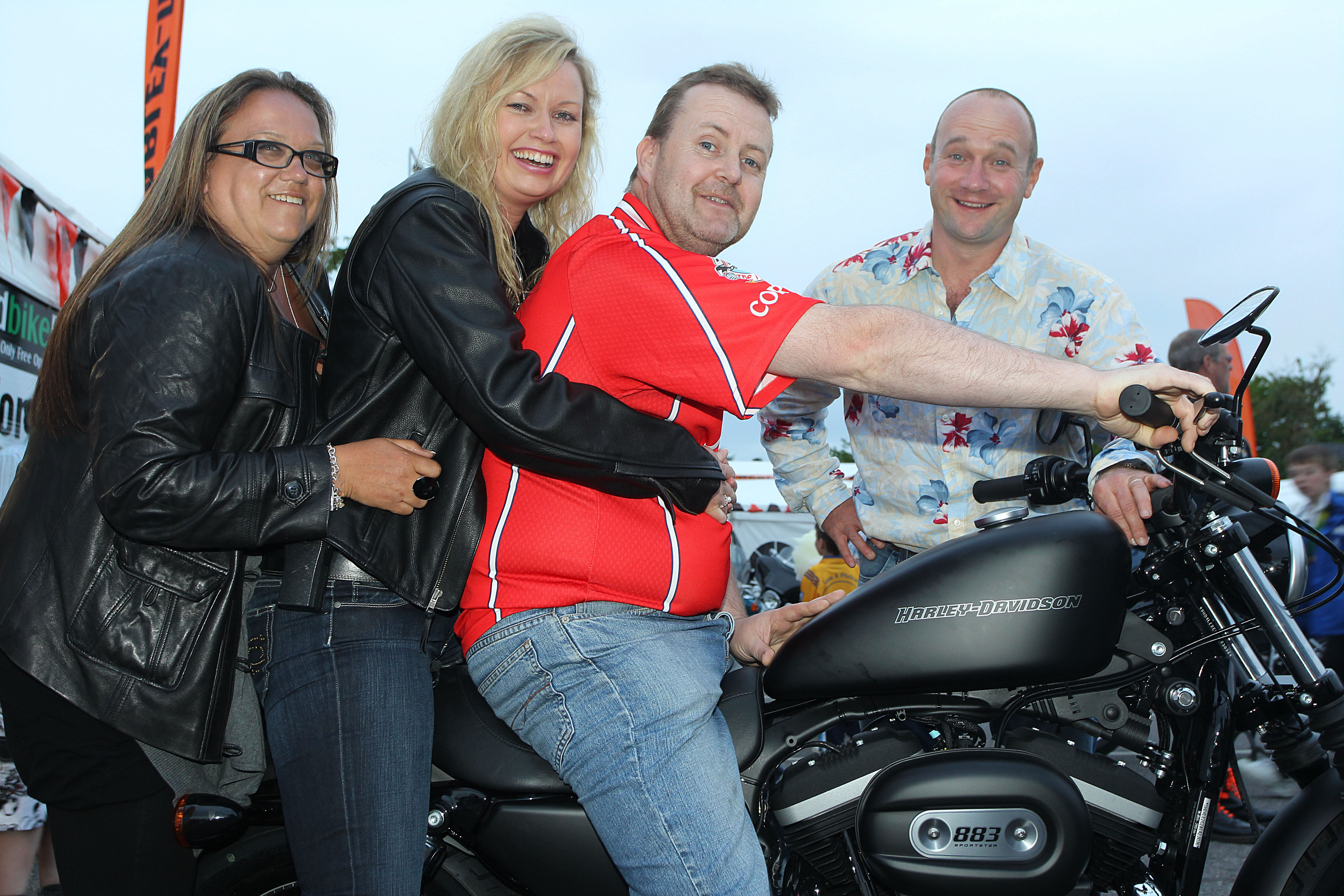 Winner alright....John McKeown, Freemount, who won a Harley Davidson Bike in the International BikeFest draw in Killarney in aid of Muscular Dystorphy Ireland (MDI) at the weekend, also included is Alison Povey, Harley Davidson Marketing Manager, Breffni Ingerton, Director, International BikeFest and Comedian Alan Shortt.Photo:Valerie O'Sullivan