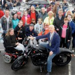 Crowd of people around a motorbike