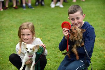 Shannon Redmond and her dog Lola with her cousin Jack Kavanagh and his dog Shadow from Enniscorthy, Wexford at the Ireland Bikefest Dog Show in the Gleneagle Hotel, Killarney at the weekend. Photo: Don MacMonagle  repro free photo from Ireland Bikefest
